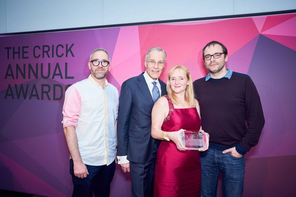 Winners at The Crick Annual Awards 2018 - holding their glass trophy award