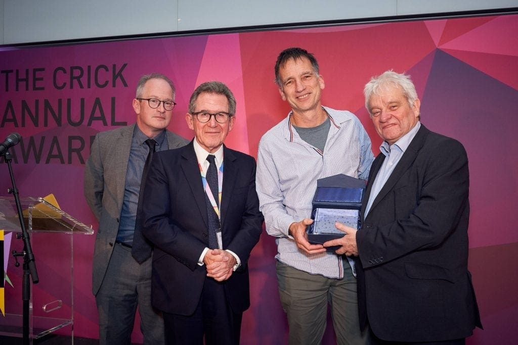 The Crick Annual Awards Event - Winners holding their glass trophy award