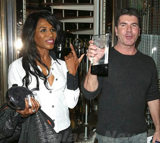 crystal plaque engraved, Simon Cowell wins an glass trophy